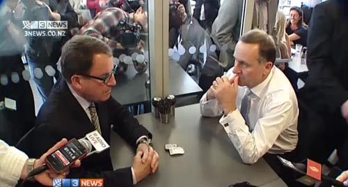 John Key and John Banks talking in an Auckland Cafe